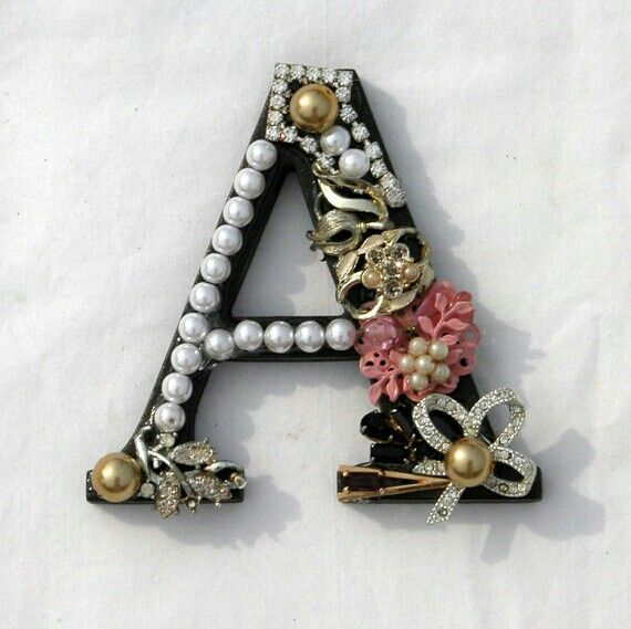 Vintage alphabet letter with jewelry