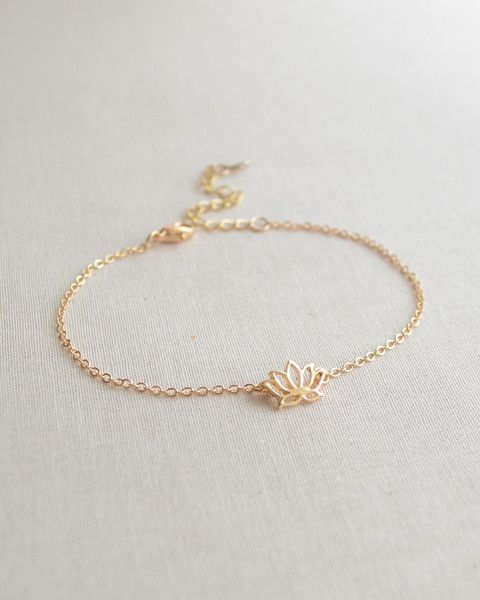 Lotus Flower Bracelet - A beautiful symbol of growth. This petite lotus charm is available in gold or silver and adjustable from 7 - 9 inches. By Olive Yew