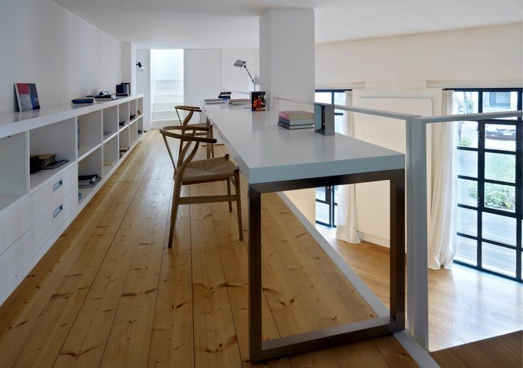 Fabio Azzolina architect - Loft - via Maiocchi - Milano  The office area is reached from the living room by a cantilever stairway. From the mezzanine level another staircase leads into the relax room facing the terrace.
