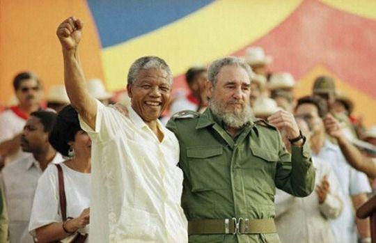 Nelson Mandela giving a speech with Fidel Castro, 1990's.