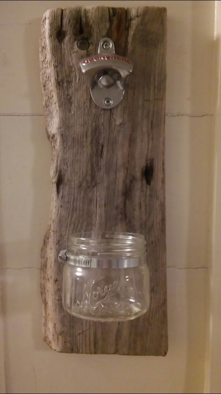 Bottle opener. Drift wood with bottle opener. And an old jar.