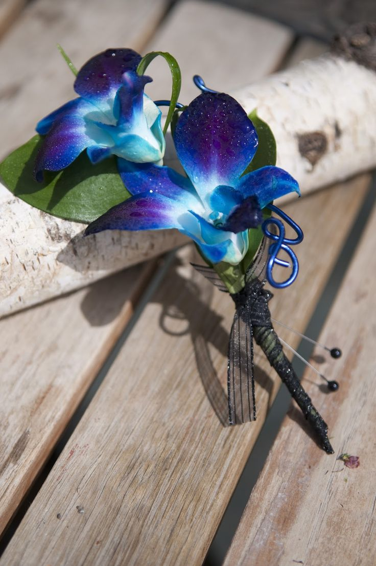 silk blue and purple dendrobium orchids tie dye boutonniere  as shown: day orchid decor