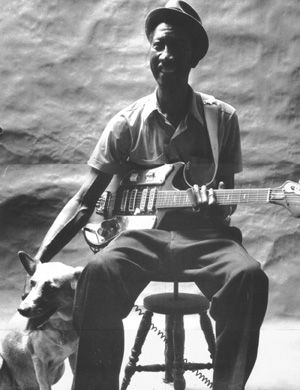 Blues guitarist Hound Dog Taylor. Llook at that smile! http://www.guitarandmusicinstitute.com