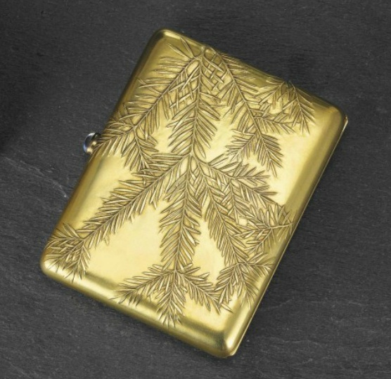 A JEWELED GOLD CIGARETTE CASE   MARKED K. FABERGÉ WITH THE IMPERIAL WARRANT, MOSCOW, 1899-1908, SCRATCHED INVENTORY NUMBER 18946.  Rectangular with rounded corners, the hinged cover repoussé and chased with stylized fern fronds, with cabochon push-piece, marked inside base, in the original silk-lined fitted case, together with a framed letter from the son of the recipient  3½ in. (8.9 cm.) wide