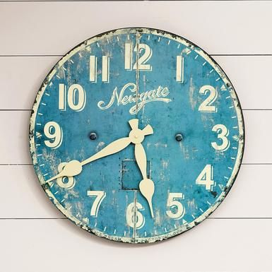 "Reminiscent of the wall clocks in old-fashioned ice cream emporiums, this well-weathered blue timepiece adds a nostalgic note to kitchen, family room, office or child's room. Printed paper dial on wood composite back with metal hands. Quartz movement. Uses one AA battery (not included). Imported. 19-3/4"" Dia."