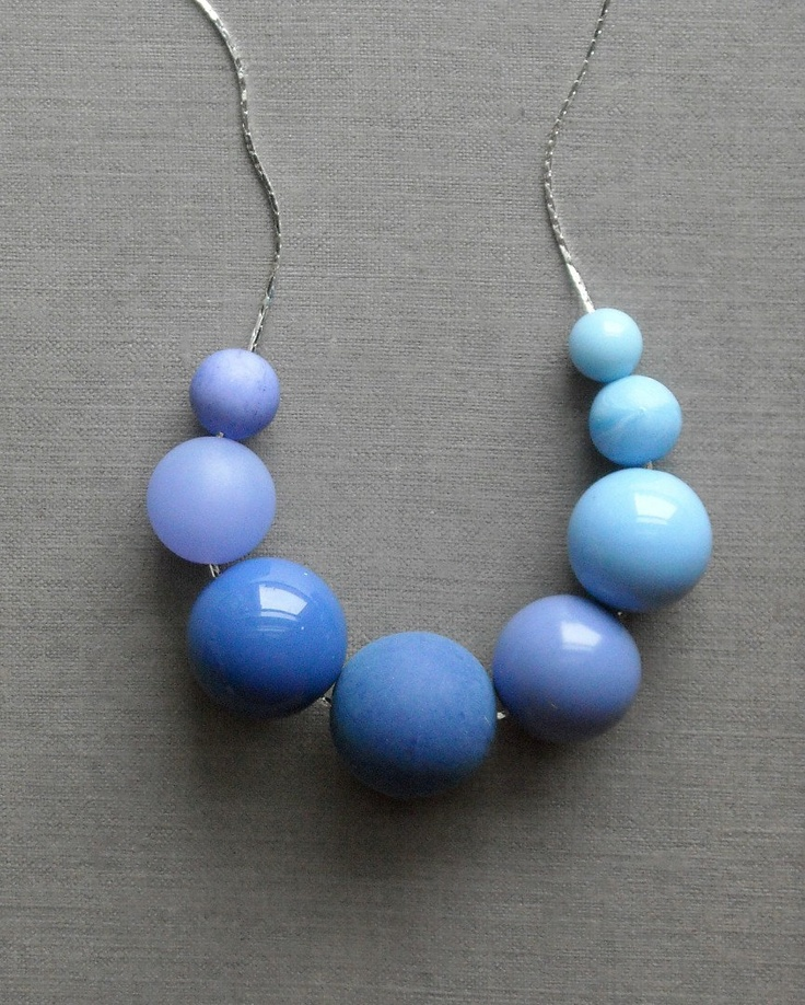 last one - ascending blues necklace - vintage lucite and silverplate. $25.00, via Etsy.