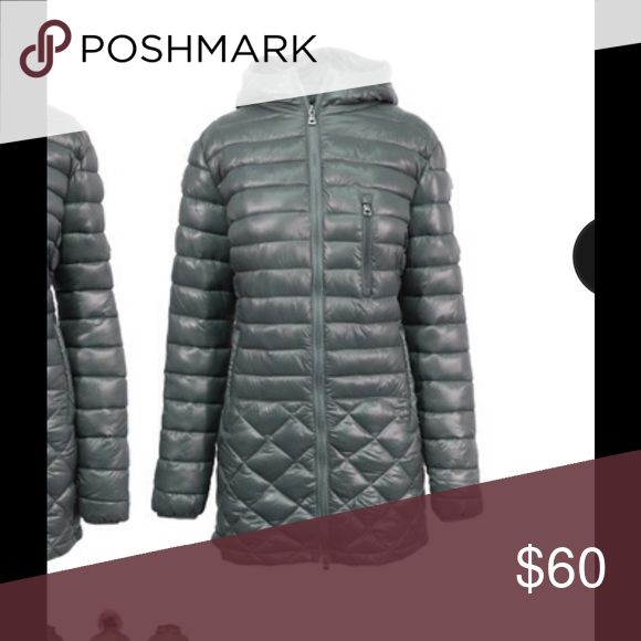 Warm Puffer Jacket Warm and very stylish jacket with a quilted puffer design. It's very light so it's easy to pack when traveling. Water resistant. Originally came with a detachable fur trim but don't have it anymore. EUC. Only worn a couple of times. Spire by Galaxy Jackets & Coats Puffers