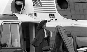 Richard Nixon waves goodbye from the steps of his helicopter as he leaves the White House following a farewell address to his staff on 9 August 1974.