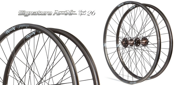 """Signature AmXc Single Speed 26"""" Signature Series Hubs combined with our 25mm-wide AmXc 26"""" Rim makes for the perfect blend of reliability and performance.... Available Hand Built from our USA Warehouse with 7 different color options for hub, rim, and spokes or as Pre-Built with Matching Rim/Hub. All Signature Series Wheelsets include Front Axle Options (9mm, 15QR, 20mm). Signature Series Single Speed Rear Hubs include a 10mm Bolt On axle and a 16t cog for simple SS Setup."""