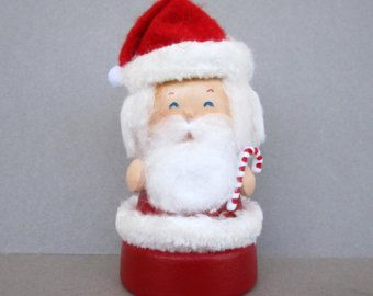 Santa and Mrs. Claus are ready for Christmas. They are made from wood and clay and are 2 1/2 tall and about 1 1/4 wide. Mrs. Claus is holding a cookie for Santa. They would make a great addition to your holiday decorations. They have lots of detail. Great gift idea too. All of my ornaments are original creations.  Thanks for checking out my shop.