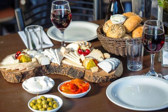This is a typical Israeli breakfast.  Fresh bread, a variety of hard and soft cheeses, fresh juice, olives, jam and butter are all regulars on the Israeli breakfast plate.