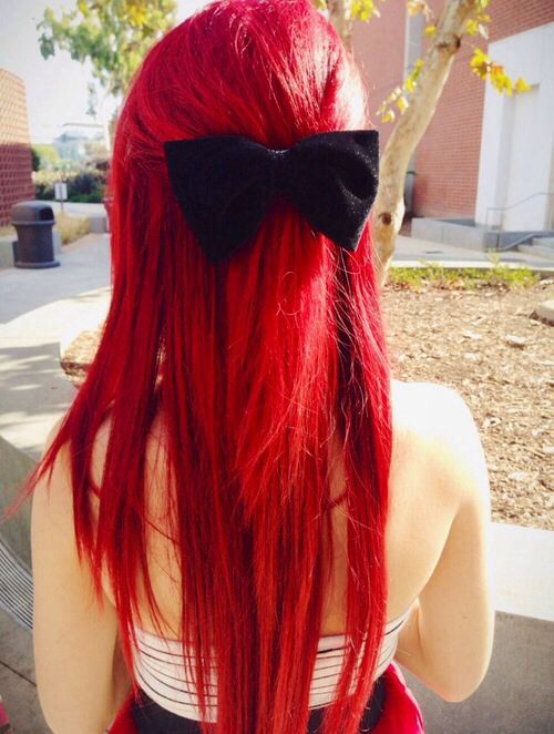 Bright red hair with black bow