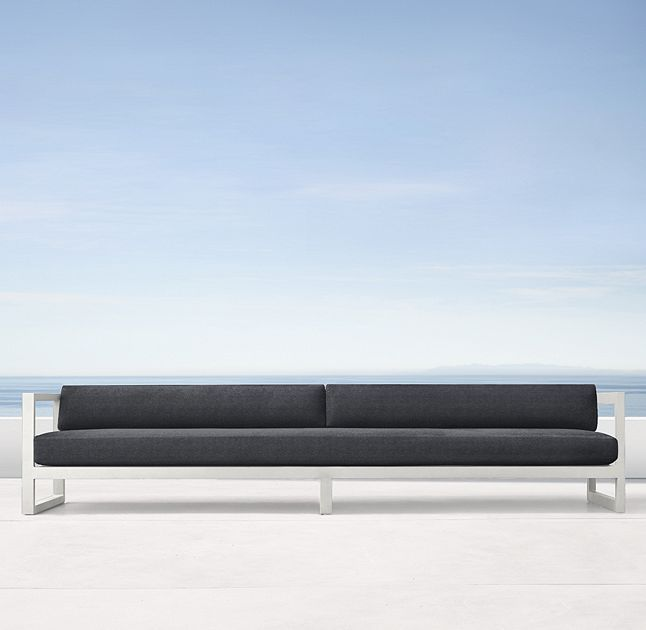"""RH's 123"""" Aegean Aluminum Sofa:Influenced by the low, linear silhouettes of seaside architecture, our contemporary collection is designed by a family-owned company in Australia known for its meticulous metalwork. Its superior materials and simple geometry enable it to weather the elements in enduring style."""