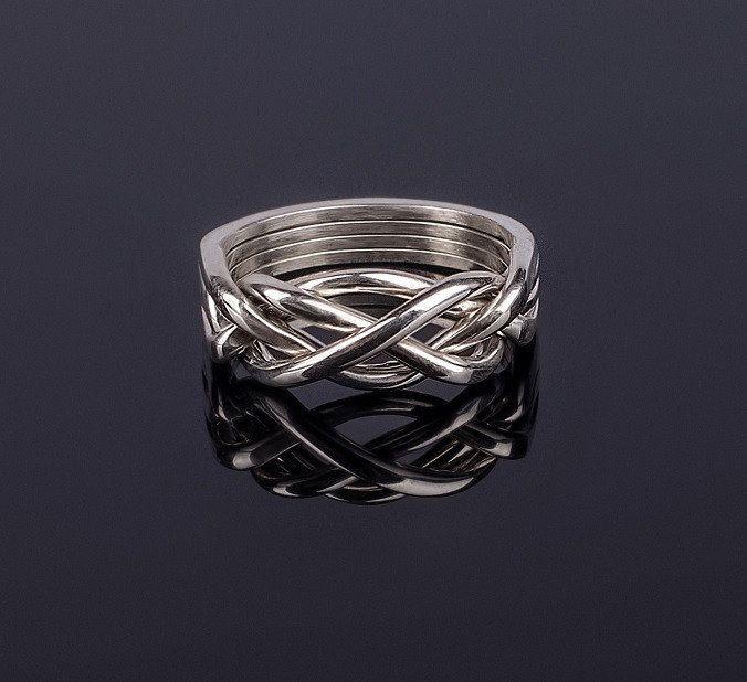 Изящное серебряное кольцо головоломка от Wickerring