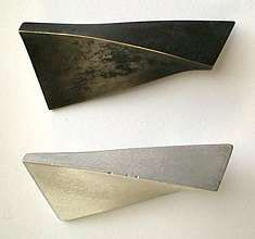 """[Ganoksin] Introduction to Basic Concrete Jewelry Four Ridge Pins: Brass, patinated black, and concrete. About 2"""" (5 cm) long. The brass pins were made first and used as molds for the concrete. 1999. © ANDREW GOSS-CANADA"""