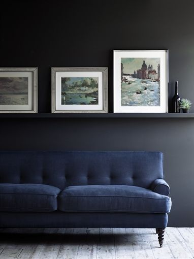 Moody blue and charcoal. Nice low picture rail too blending in with wall colour …