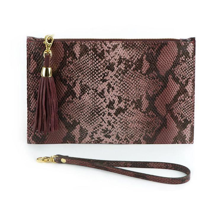 Clutch+Celine+Snake+Print+-+Aubergine+-+Our+Celine+clutch+is+a+classic+accessory,+it+is+the+perfect+size+for+going+out.+The+snake+embossed+leather+makes+it+a+fashion+item+and+its+matching+aubergine+back+allows+you+to+use+it+in+many+different+ways.+Tassel+ #clutch #bag #snakeprint #leather #accessory #fashion #aubergine #party #handbags
