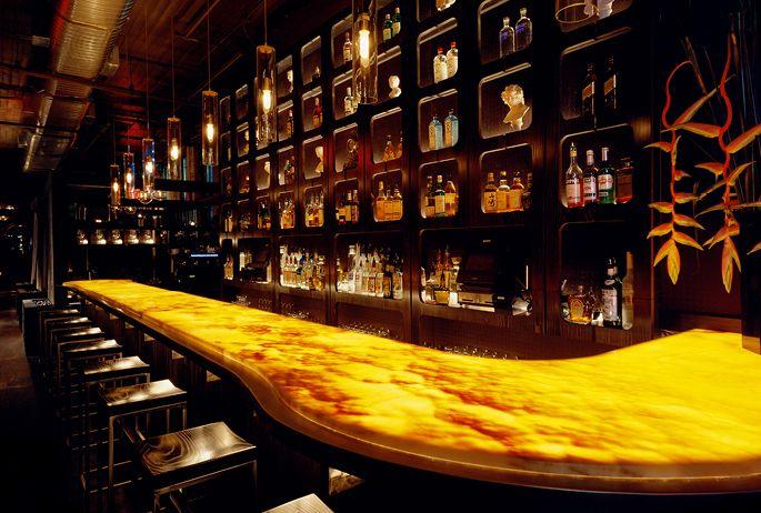 Odea Lounge | AvroKo - under-lit onyx bar