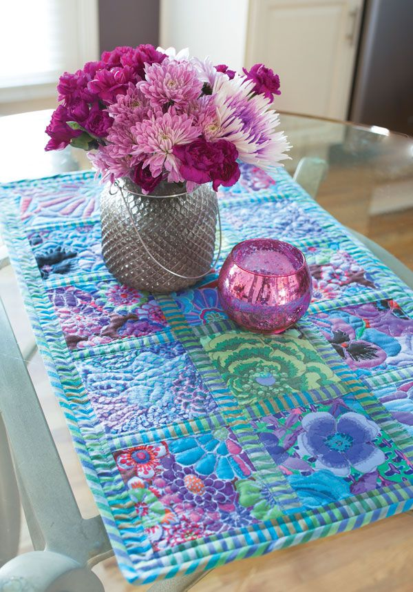 Stripes and florals form a stylish duet in this table runner by Deborah Shafer. This is a great way to show off large prints and make each one shine on its own. Learn how to make Charmed, I'm Sure in our free video tutorial.