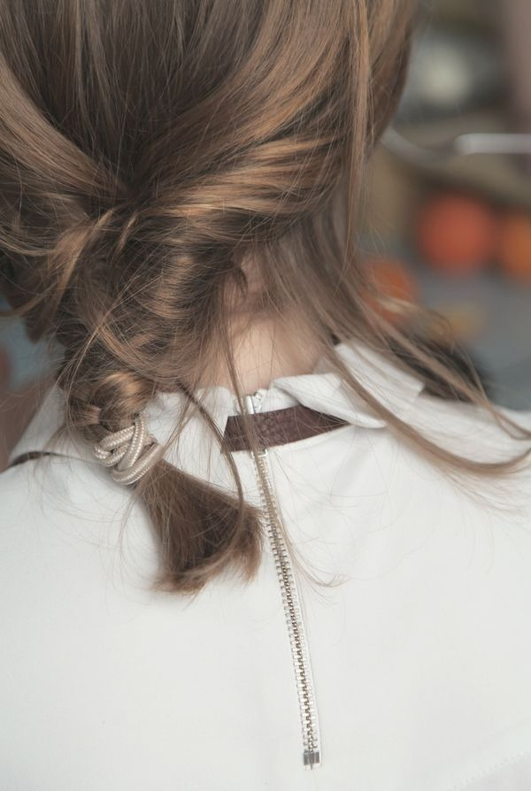 Loose Low Braid | Mussed and Messy | Wisps and Larger Pieces Falling Free of Elastic HER NEW TRIBE — (via PINNED | HER NEW TRIBE | hernewtribe.com)