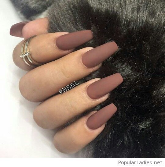 Matte brown long nails with a gold ring