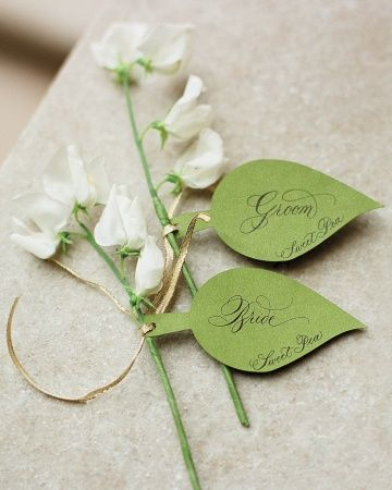 A beautiful escort card becomes even more delightful when attached to a fragrant bloom. Write your guests' names out on a leaf-shaped cutout, and tie to various stems that match your color scheme