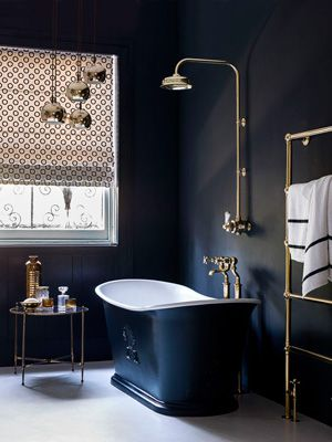 Charcoal grey bathroom with free-standing bath; modern bathroom design at allaboutyou.com