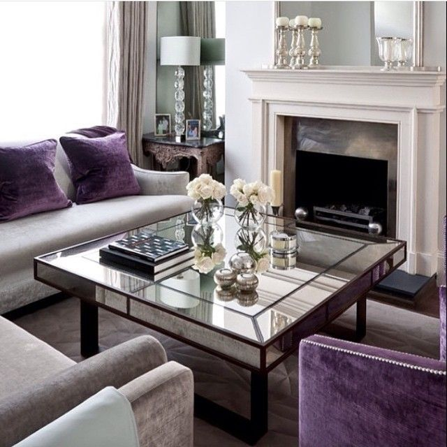 Love the purple chair and matching cushions on the other sofa!