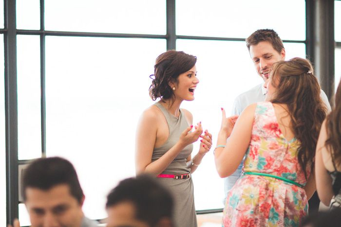 bride talking with guests at reception