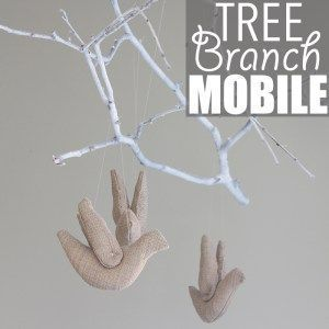 Tree Branch Mobile by Of Houses and Trees   Super charming and whimsical DIY tree branch mobile made with a spray-painted poplar branch, stuffed birds and fishing line.