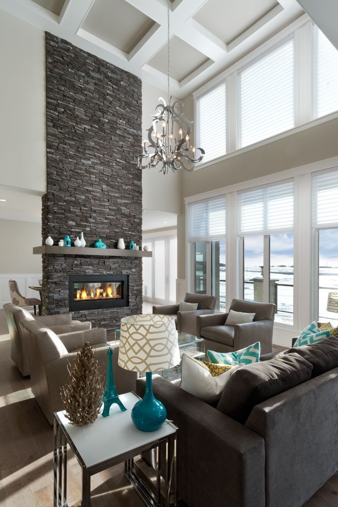 There are so many things we love about this customer's home - 2-way gas fireplace with stone face to the ceiling, coffered ceiling details and the open to above with the extra windows.