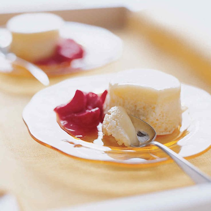 This lemon sponge pudding separates as it cooks into a layer of cake and a delicious custardy layer of curd; the pudding is served with rhubarb sauce.