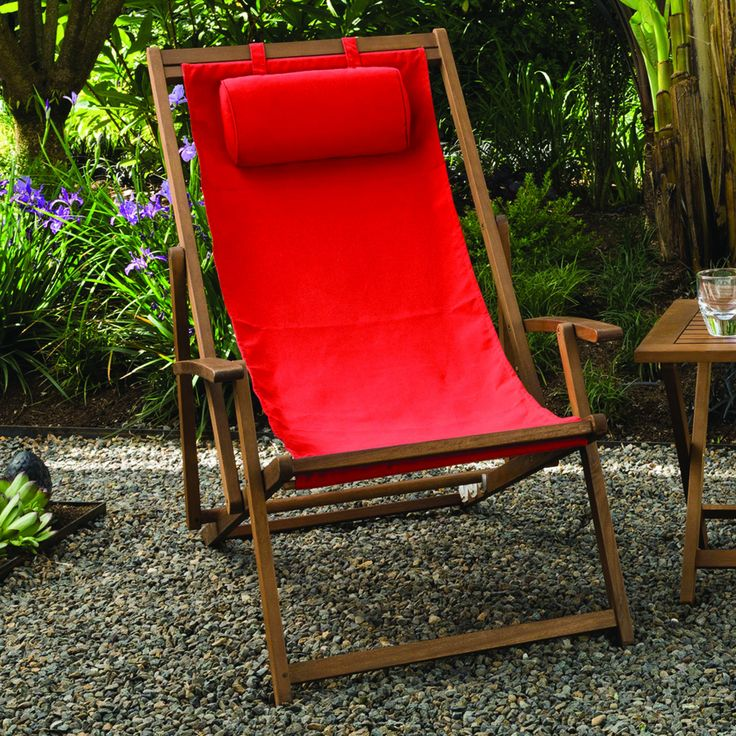 Relax the entire afternoon while sitting in this comfortable sling chair from Phat Tommy. A premium hardwood and durable polyester define this chair.