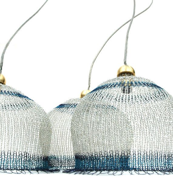 These Crocheted Lampshades ($280) are made from copper wire in silver and blue.