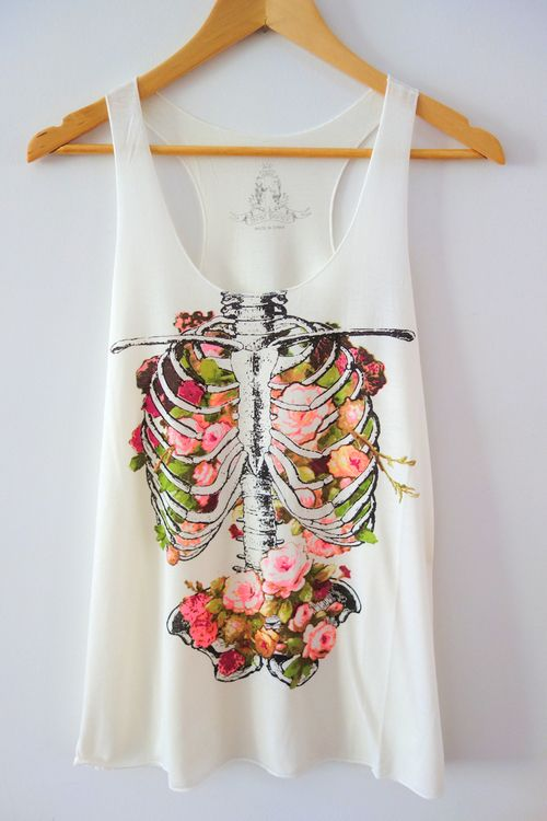 She Is Love Floral Ribcage Tank Top | Show off your beauty from the inside out with this super soft semi-loose white tank top. This tank top features a floral ribcage graphic on the front. | Chapter24
