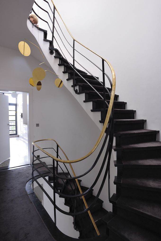 Staircase with DSHOP's Céleste Mobile in brass