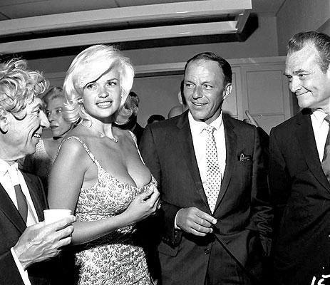 L-R Harpo Marx, Jayne Mansfield, Frank Sinatra, and Red Skelton at a party held at the Palm Springs Racquet Club, 1959