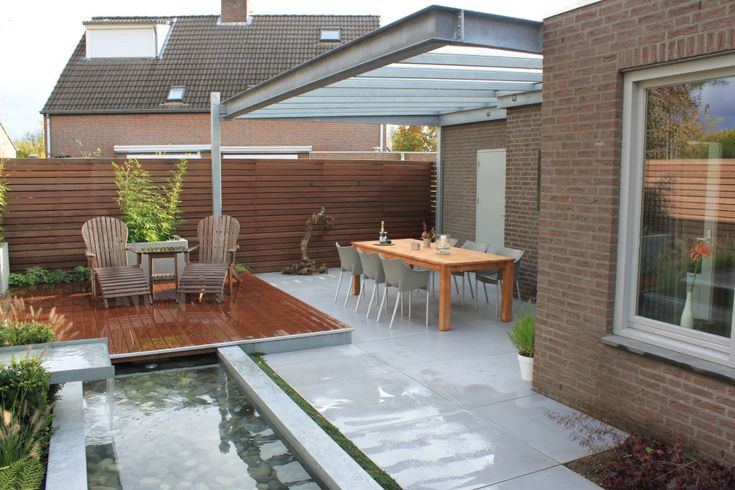 Foto's van een moderne tuin: patiogarden with steel pond and water feature | homify