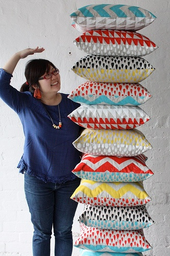 Dawn Tan with beautiful screen printed pillows made at the Harvest Workroom in Brunswick.
