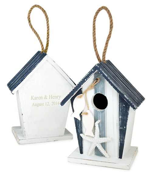 "Nautical Beach Bird House Size: 5.25""L x 3.5""W x 7""H The feelings of the love bird are always known, and now you can show it in physical form with this Nautical Beach Wood Love Bird House. This beach style bird house is a unique display item that can be used as a party favor, a table centerpiece, given as a gift or purchased for oneself. Bring the beach to any part of your home or yard with this nautical styled bird house with its natural theme and oceanic design. The classic blue and white…"
