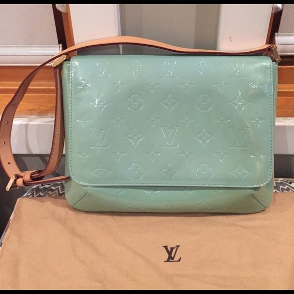 """Shop Women's Louis Vuitton Blue size 10""""L x 2.25""""W x 8""""H (H=20"""" with handle) Shoulder Bags at a discounted price at Poshmark. Description: 🎊 🎊 HP Best in Bags Party 🎉🎉Authentic Louis Vuitton shoulder bag! Barely used but discoloration is present and can be seen in the image. Slight water marks at the inverse side of handle. Comes with LV duster bag. See other post for matching shoes!. Sold by ally_marc. Fast delivery, full service customer support."""