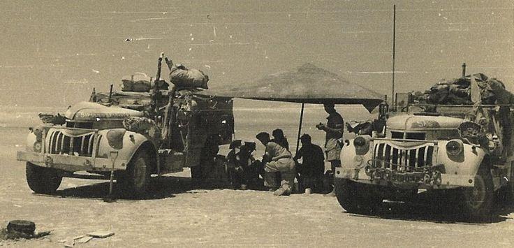An LRDG patrol takes a break by their heavily loaded Chevys in the Western Desert in 1943