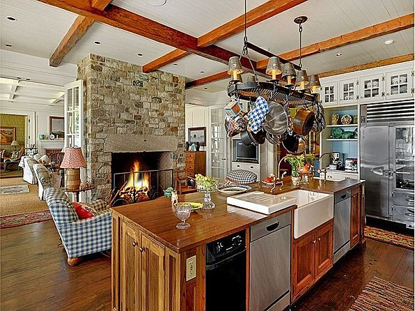 Great kitchen! Love the fireplace and how the kitchen is open to the living area.