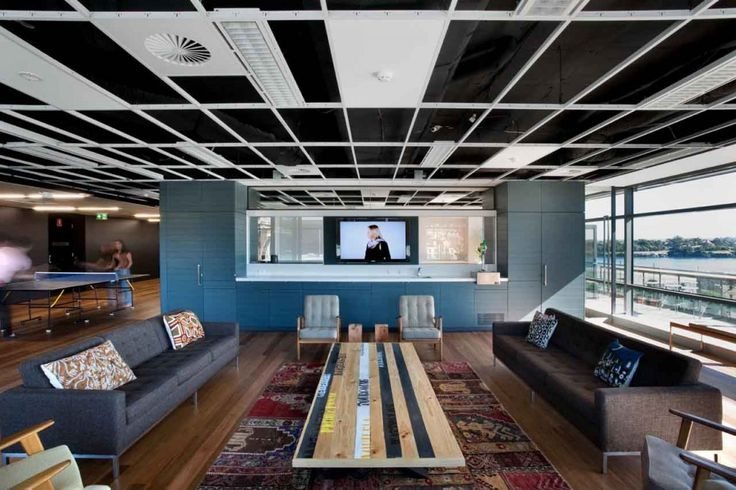 Ceiling treatment for Engineering/Product Development - exposed ceiling to deck painted black with white ceiling grid intermittent ties