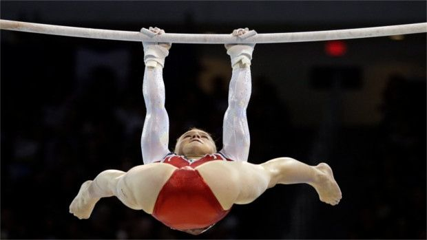 BODY BENDS BETTER THAN BAR - The United States' Madison Desch performs on the uneven bars with what looks like an incredibly uneven body.
