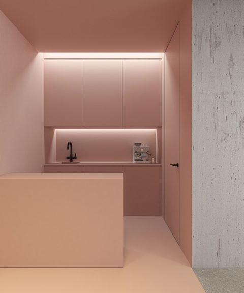 Minimalismo na cozinha! No ambiente do arquiteto Emil Dervish, um rosa suave toma conta de quase todas as superfícies, retas e lisas, exceto uma parede de concreto que se dirige para o cômodo seguinte. Veja mais detalhes em casavogue.com.br #casavogue #cozinhaminimalista