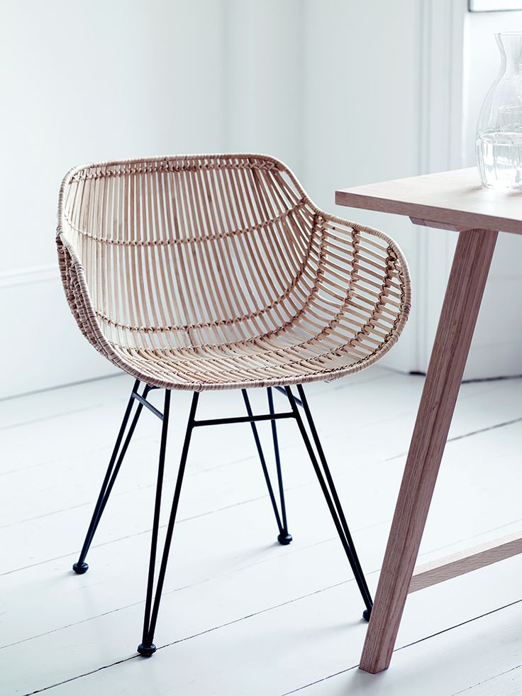 Inspired by classic 1950's design and material, our stylish armed chair has a strong black iron frame and woven rattan in tonal shades of blonde. Our contemporary twist on this classic design has been especially designed for your comfort with a wide shaped seat, two low arms and curved back. Team with our Rattan High Stool and Rattan Dining Chair for the complete look.