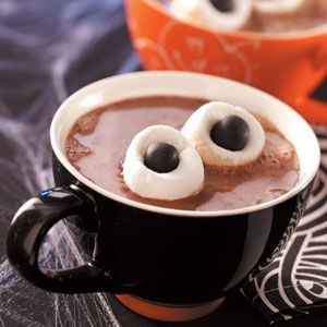 Monster hot chocolate.. Marshmallows and whoppers very cute for those cold Halloweens