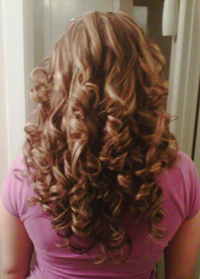 Curly hairstyle with brunette and honey highlights haircut in layers and face framed