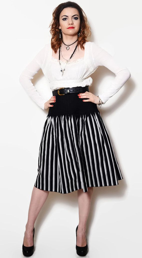Vintage beautiful black and white midi skirt.  The model on the pictures is size S/36 and 165 cm height. Please check measurements with your own to avoid problems with the size. Make sure you double the measurements where shown (*2):  Label size: 36/ S Total lenght: 69 cm / 27.25 inches Waist: 36 cm *2 / 14.25 inches *2 Hips: 48 cm *2 / 19 inches *2 Bottom Width: 95 cm *2 / 37.5 inches *2 (open)  Label: Betty Barclay Condition: very good Colors: Black, White Circ...
